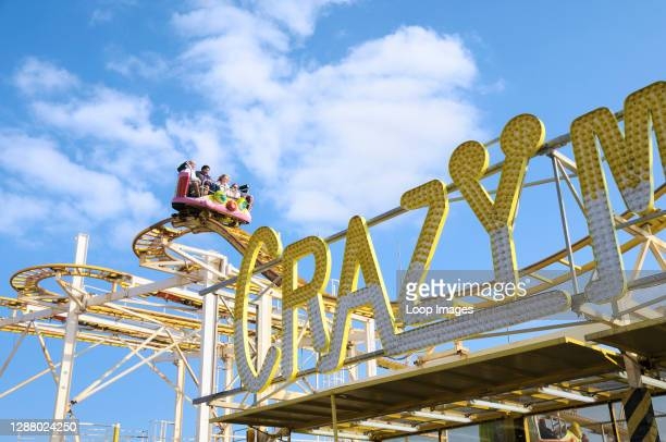 People enjoying the Crazy Mouse rollercoaster ride at the funfair on Palace Pier in Brighton.