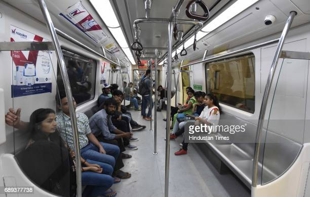 People enjoying the first metro ride at ITO to Kashmere Gate section after Union Minister of Urban Development M Venkaiah Naidu and Chief Minister of...