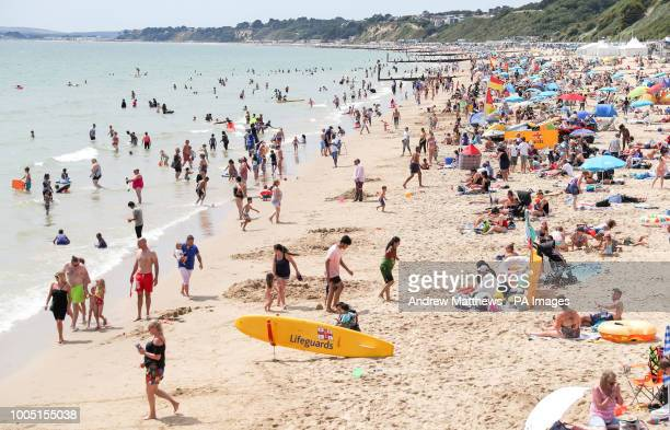 People enjoying the heatwave today on Bournemouth beach in Dorset as the hot weather continues across the UK marking the driest start to a summer...