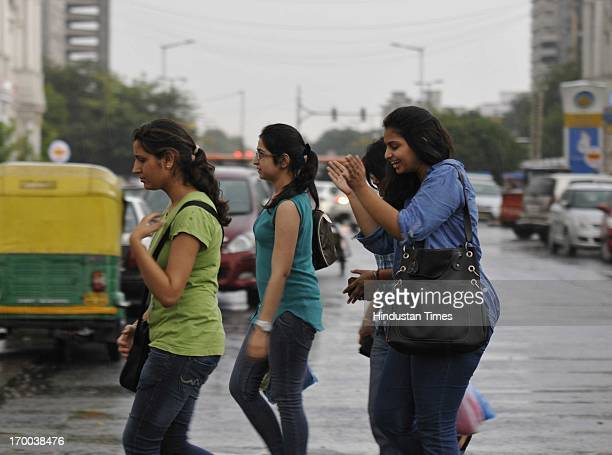 People enjoying the pre monsoon rain after hot summer day on June 6 2013 in New Delhi India Rain and strong winds lashed the capital Thursday evening...