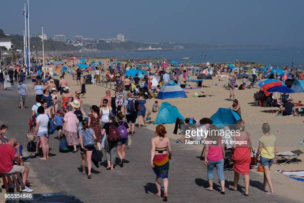 People enjoying the sunshine at Branksome Beach Poole as sun worshippers are set to sizzle in the spring heatwave with Bank Holiday Monday forecast...