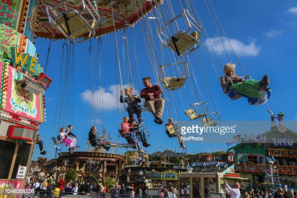 People enjoying the swing carousel on Day 12 of the Oktoberfest The Oktoberfest is the largest Volksfest in the world It will take place until Sunday...