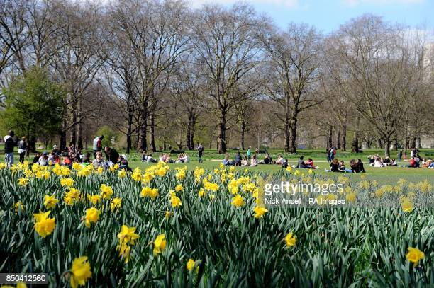 People enjoying the warm spring weather in Green Park central London