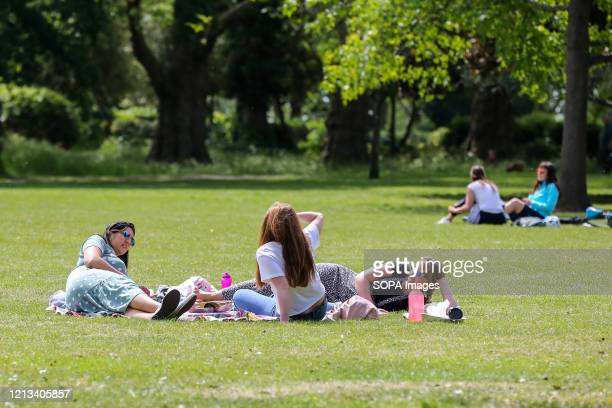 People enjoying the warm weather in Finsbury park during the COVID19 lockdown The government has relaxed the restrictions on coronavirus lockdown to...