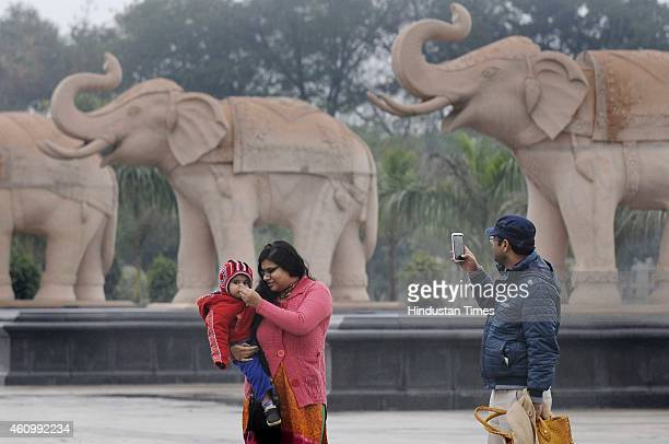 People enjoying the weather at Dalit Park as city witnessed cold day after light rains on January 3 2015 in Noida India Delhi NCR has a homeless...