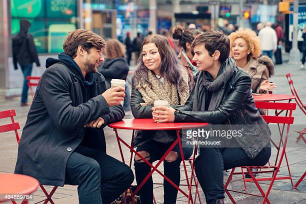 "people enjoying themselves in times square red chairs place. - ""martine doucet"" or martinedoucet stock pictures, royalty-free photos & images"