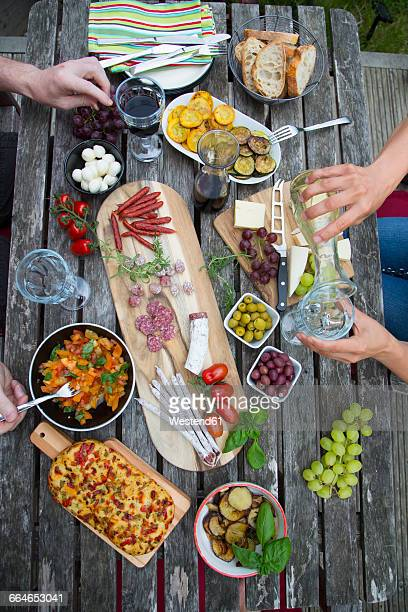 People enjoying variety of Mediterranean antipasti