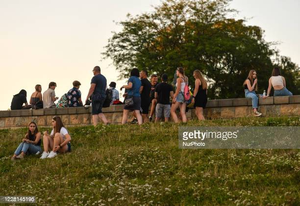 People enjoying warm evening outdoors near the Vistula river in Krakow. The number infected by the COVID-19 continues to grow in Poland. The Health...