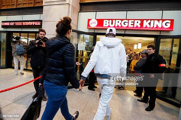 People enter a Burger King store at Saint-Lazare railway station in Paris, on December 16 on its inauguration day. It is the fourth Burger King store...