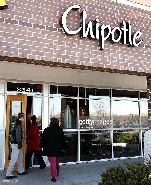 People enter a Chipotle restaurant December 2 2005 in Glenview Illinois McDonald's Corp owners of 92 percent of Chipotle are preparing their...
