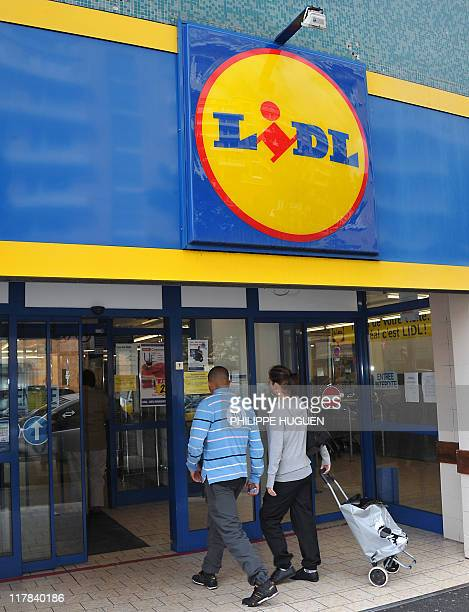 People enter a discount supermarket LIDL on June 16 2011 in the northern French town of Lille Six children were being treated in hospital today in...