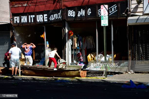 People enter a looted furniture store during a protest of the death of George Floyd on May 31 2020 in Philadelphia Pennsylvania Protests have erupted...