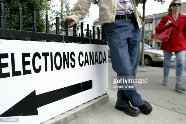 People enter a polling station to vote in the federal election to determine the next prime inister of Canada on June 28 2004 in Toronto Canada The...