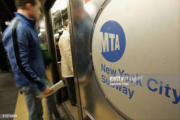 People enter a subway car at Times Square October 26 2004 in New York City The New York City subway system opened 100 years ago on October 27 when...