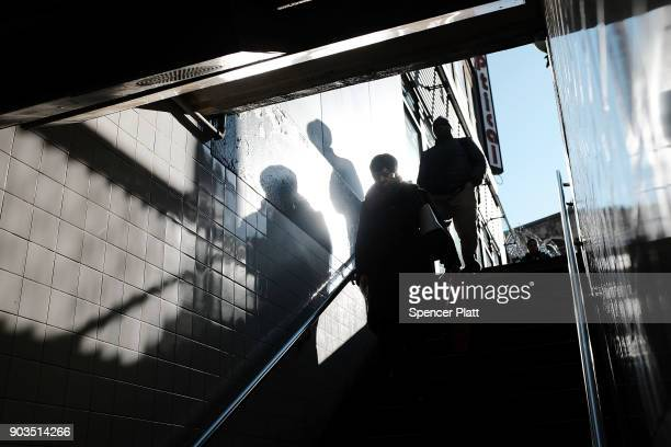 People enter a subway station on January 10 2018 in New York City The New York City subway system which opened in 1904 and is the world's largest...