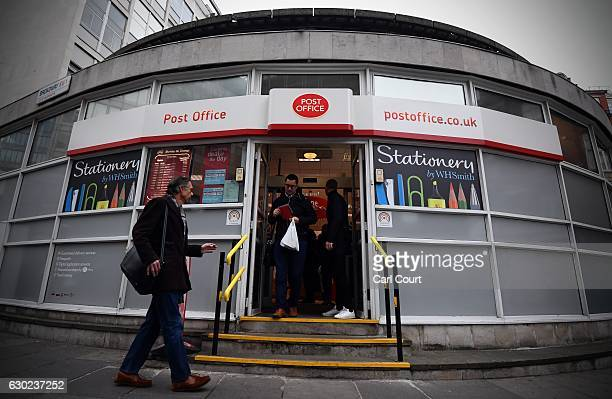 People enter and leave a Post Office branch on December 19 2016 in London England A strike at Crown post offices has closed around 50 of the 300...