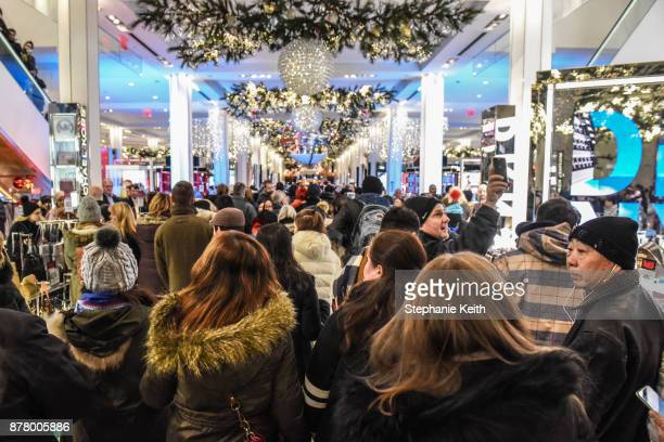 People enter Macy's department store to start shopping on 'Black Friday' on November 23 2017 in New York City Black Friday starts earlier in the...