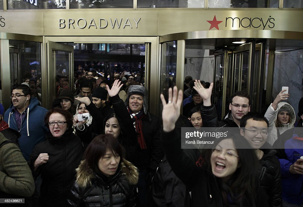 People enter Macy's Herald Square as the store opens its doors at 8 pm Thanksgiving day on November 28, 2013 in New York City. Black Friday shopping began early again this year with most major retailers opening their doors on Thanksgiving day.