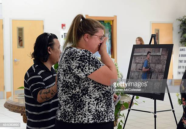 People enter Our Lady of the Rosary Church for a special mass in remembrance of journalist James Foley August 24 2014 in Rochester New Hampshire...