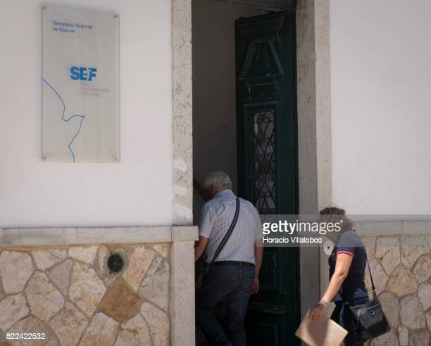 People enter Portugal's SEF Regional Delegation on July 25 2017 in Cascais Portugal According to the SEF the number of citizens from other European...