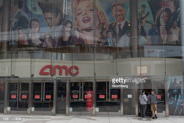 People enter the AMC movie theater at the Westfield Century City shopping mall in Los Angeles, California, U.S. On Monday, March 15, 2021....