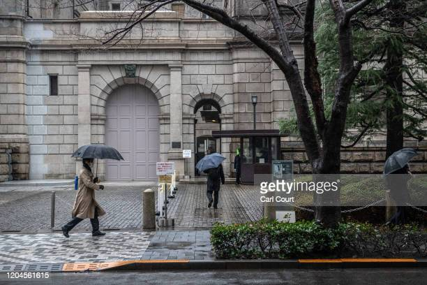 People enter the Bank of Japan in Tokyo's financial district on March 2, 2020 in Tokyo, Japan. Prime Minister Shinzo Abe continues to urge Japanese...