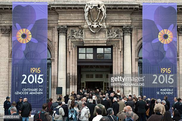 People enter the City hall to attend a ceremony as part of the 100th anniversary of the Armenian Genocide on April 16 2015 in Marseille southern...