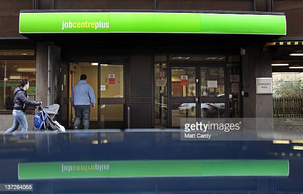 People enter the Jobcentre Plus office on January 18 2012 in Bath England Figures released today show that the UK unemployment rate has risen to a...