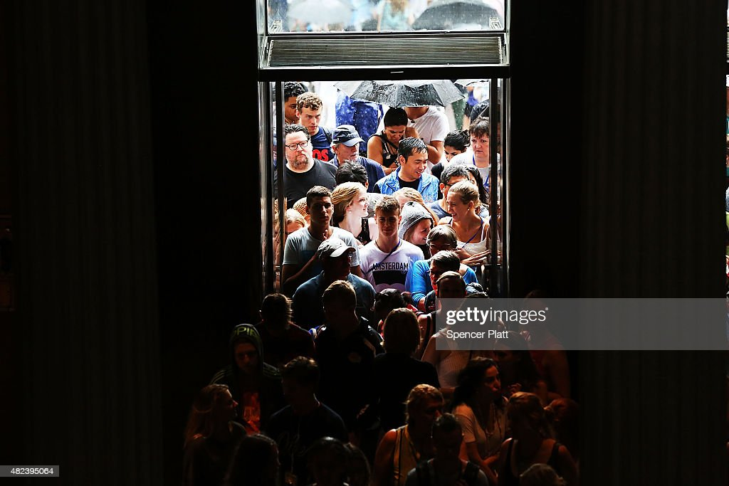 People enter the Metropolitan Museum of Art (the Met) on July 30, 2015 in New York City. The Met recently announced that it drew 6.3 million visitors in the last year, the most since the New York museum began taking crowd statistics more than 40 years ago. Tourism in New York has continued to grow, hitting record numbers in the last few years as people flock to Manhattan and Brooklyn for the cultural institutions, nightlife and shopping.