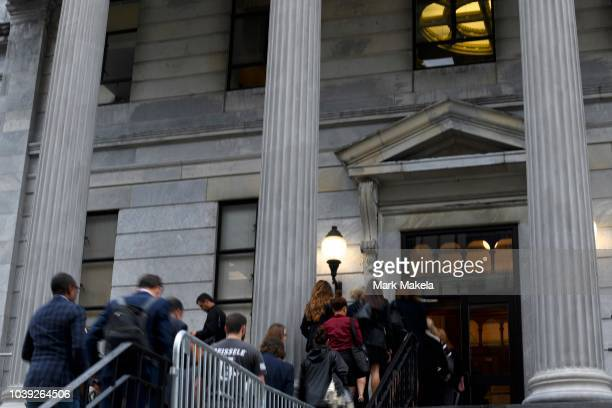 People enter the Montgomery County Courthouse on the first day of sentencing in Bill Cosby's sexual assault trial on September 24 2018 in Norristown...