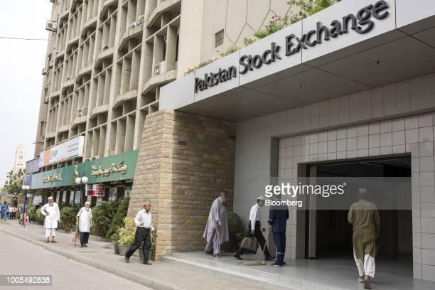 People enter the Pakistan Stock Exchange building in Karachi Pakistan on Thursday July 26 2018 Former cricket starImran Khanwas close to winning an...