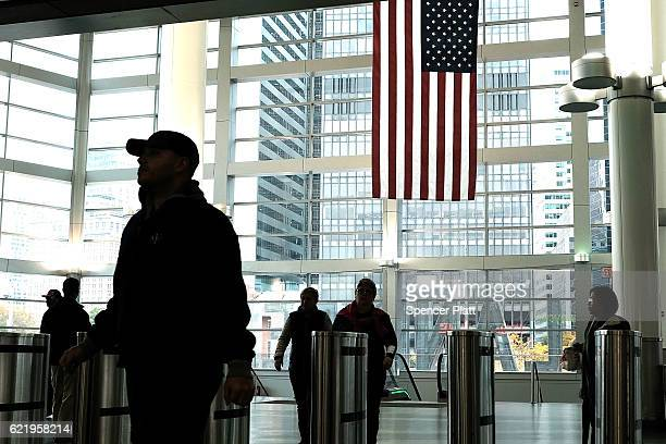 People enter the Staten Island Ferry terminal on November 9 2016 in New York City Global markets originally dropped after Donald Trump began to pull...