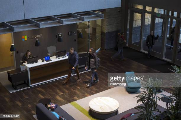 People enter the Studio B building of the Microsoft Corp main campus in Redmond Washington US on Tuesday Dec 19 2017 In the race to commercialize a...