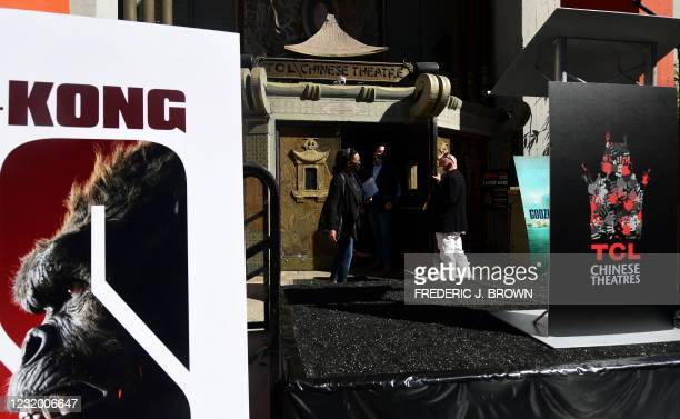 People enter the TCL Chinese Theater in Hollywood, California during its reopening on March 29, 2021. - The four directors of current and previous...