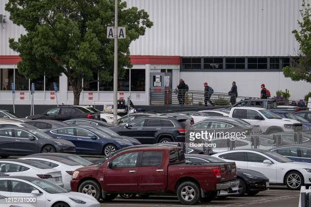 People enter the Tesla Inc assembly plant in Fremont California US on Monday May 11 2020 Elon Musk restarted production at Tesla's only US car plant...