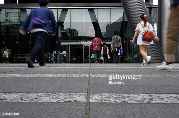 People enter the venue for the Takata Corp annual general meeting in Tokyo Japan on Thursday June 25 2015 Fiat Chrysler Automobiles NV is switching...