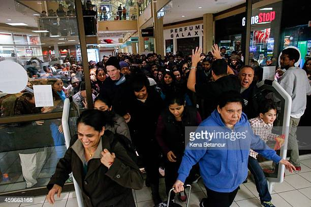 People enter to JCpenny store on the Newport Mall on November 27 2014 in Jersey City New Jersey United States Black Friday sales which now begin on...