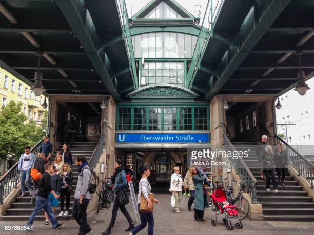 people entering and exiting a train station. - prenzlauer berg stock photos and pictures