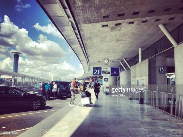 People entering Roissy Charles de Gaulle Airport in Paris, France