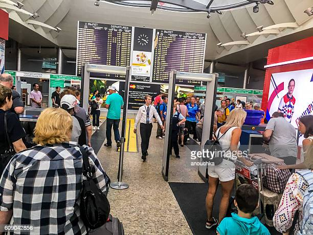 People entering Sheremetyevo Airport through metal detectors, Mo