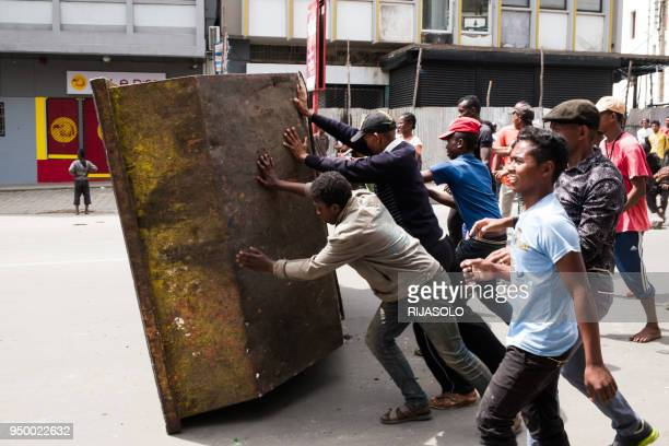 People erect a roadblock, during a rally in the centre of Antananarivo, on April 22, 2018 to protest against the new electoral laws. - Dozens of...