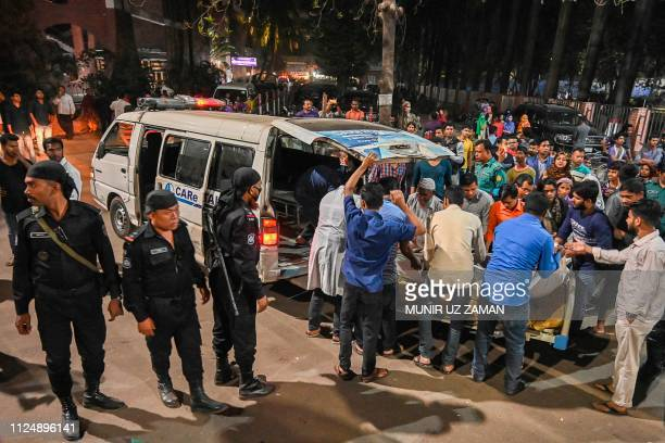 People evacuate a patient from Shaheed Suhrawardy Medical College and Hospital in Dhaka after a fire broke out on February 14 2019 Around 1500...