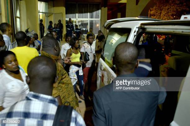 People evacuate from the area of a restaurant on August 14 2017 in Ouagadougou following a deadly attack by gunmen resulting in 18 deaths At least 18...