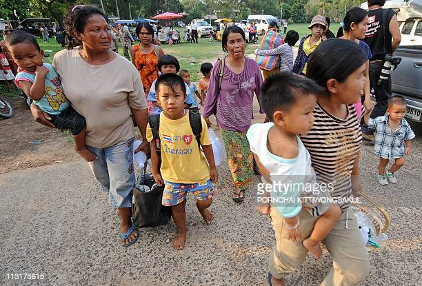 People evacuate their homes following a deadly exchange of gunfire between Thai and Cambodian soldiers at Kantharalak district in Sisaket province...