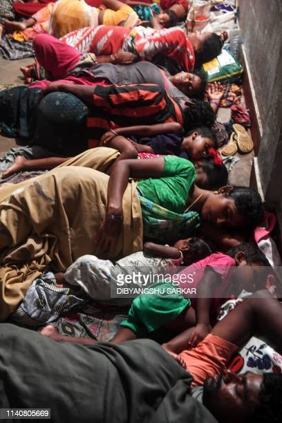 People evacuated for safety rest in a temporary cyclone relief shelter in Puri in the eastern Indian state of Odisha on May 3 as cyclone Fani...