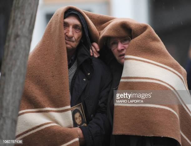 People evacuated from their homes, protect themselves from the rain with a blanket, in the Abruzzo capital L'aquila, epicentre of an earthquake...