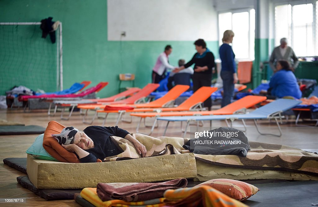 People evacueted from flooded area of Swiniary village are housed in the school gym in Slubice, on May 25, 2010. Torrential rain in Poland's mountainous south have caused rivers, including the Vistula, Poland's largest, swell to levels unseen in more than a century.