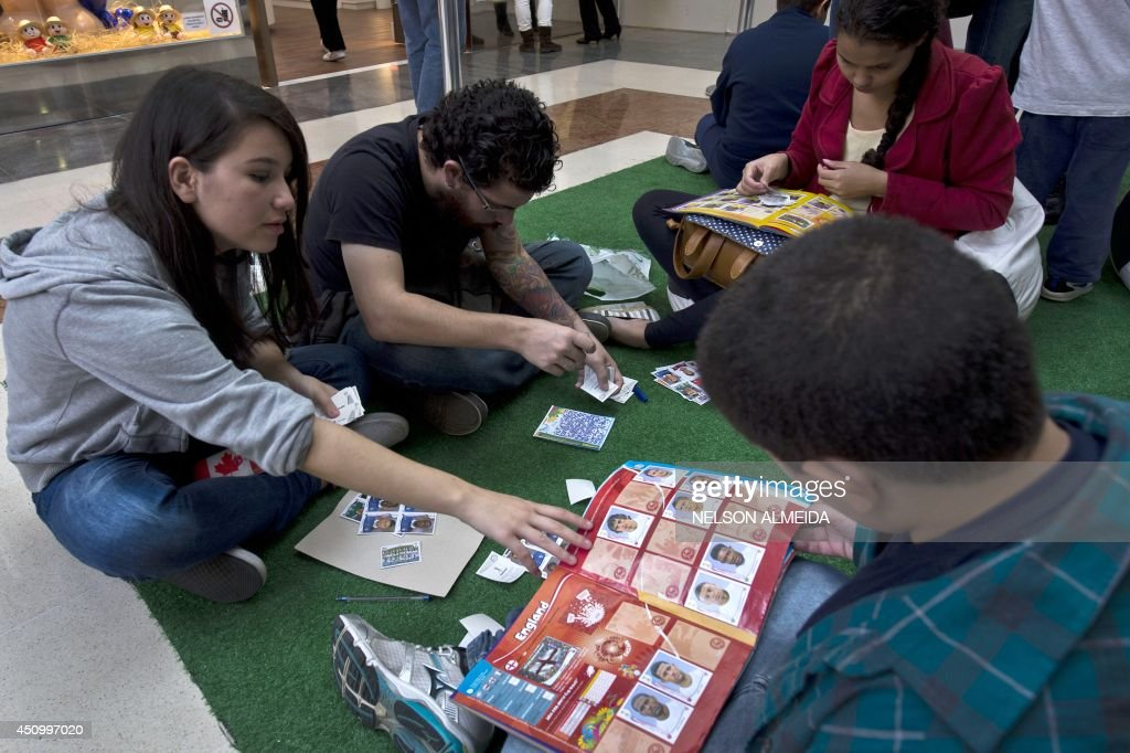 People exchange and buy stickers of the FIFA World Cup album in a shooping mall in Sao Paulo, Brazil, on June 21, 2014.