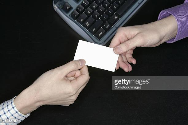 People exchanging a business card