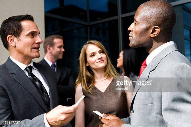People exchanging business cards